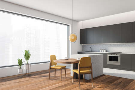 Open space home interior with gray wall and black kitchen set, panoramic window, side view. Dining table with yellow chairs, city view on skyscrapers, 3D rendering no people Imagens