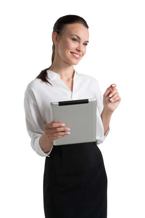 Office woman in white shirt and skirt, tablet in hand, standing smiling. Concept of business worker, isolated over white background Banco de Imagens