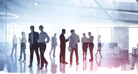 Silhouettes of diverse business people working together, toned image of office interior and skyscrapers. Concept of modern office with managers, partners
