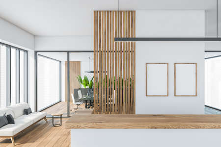 Bright modern minimalist office room interior with two empty poster, wooden parquet floor, panoramic window, reception desk, computer, glass partition. Concept of business meeting place. Close up view