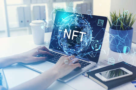 Businesswoman hands on keyboard of laptop, non-fungible token hud double exposure, nft with earth globe and network icons. Concept of cryptocurrency and technology