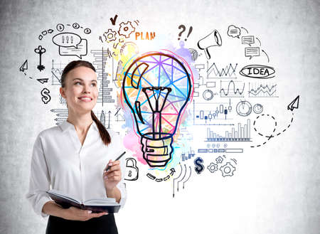 Office woman with pencil and business notes near lightbulb sketch with circuit of network connection, graphs and financial analysis. Concept of business idea and management