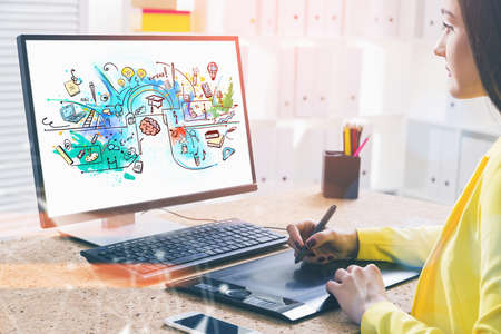 Over the shoulder shot of attractive woman graphic designer drawing vector illustration on desktop. Colorful sketches of educational and learning process on display. Concept of business university Imagens