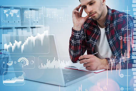 Office man in casual clothes using laptop, office interior. Stock market changes candlesticks in icons, data information icons and rising graph. Concept of finance and trading