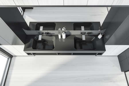 Modern design bathroom interior with double sink countertop, silver faucets, big mirror. Black tile and wooden panels walls. Public wc hands wash concept. Top view. 3d rendering.