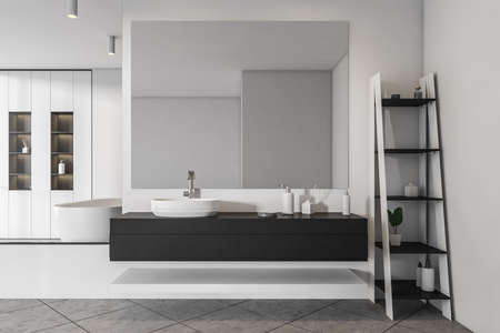 White bathing room interior with sink and mirror, shelf with accessories, front view. Gray tiled floor and rack with gels and bottles. 3D rendering
