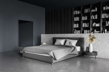 Gray bedroom interior with bed and coffee table with vase on concrete floor, wooden bookshelf with books and decoration. Art sleeping room, 3D rendering no people Imagens