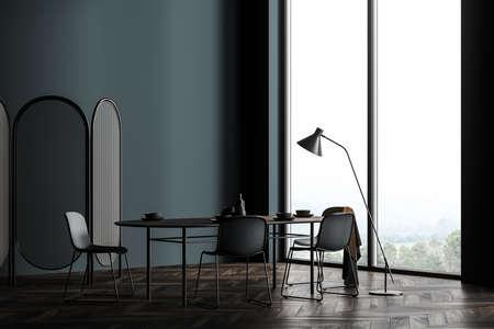 Corner of stylish Scandinavian dining room with dark gray walls, wooden floor, long table with chairs and window with blurry mountain view. Concept of interior design. 3d rendering