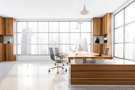 Light wooden office manager room interior with table and desktop computer, black armchairs on concrete floor. Windows with city view on skyscrapers, 3D rendering Imagens