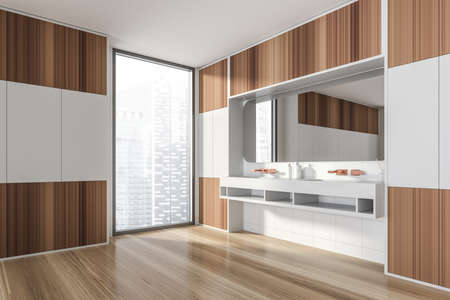 Modern design bathroom interior with double sink countertop, bronze faucets. Panoramic window with skyscrapers city view. Wood and white tile walls. Public wc hands wash concept. 3d rendering. Imagens