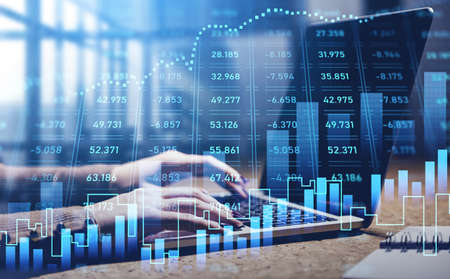 Businesswoman hands or stock trader analyzing stock graph and financial indicators of market using laptop to buy or sell shares, internet trading Imagens