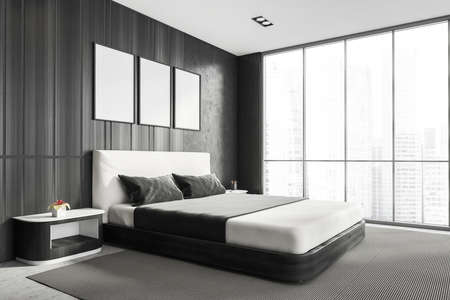 Modern stylish bedroom interior with gray walls, concrete floor, master bed and Panoramic window. Three White framed posters on the wall. Mockup concept. 3d rendering