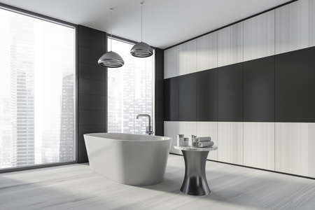 Modern design bathroom interior with white oval bathtub, silver faucet, lamp. Small table with towel and cosmetics. Panoramic window with skyscrapers city view. Wood materials. 3d rendering.