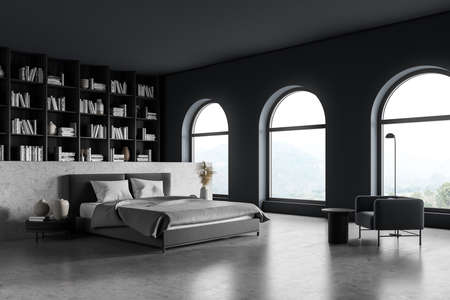 Gray bedroom interior with bed and linens on concrete floor, side view, big bookshelf with books and decoration, armchair with lamp and coffee table. Art bedroom with panoramic windows, 3D rendering