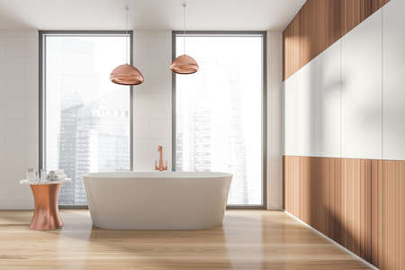 Modern design bathroom interior with white oval bathtub, bronze faucet, lamp. Small table with towel and cosmetics. Panoramic window with skyscrapers city view. Wood materials. 3d rendering.