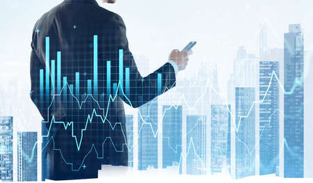 Office man working with smartphone, city bar chart with skyscrapers on background. Stock market changes. Concept of trading and financial growth Imagens