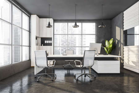 Gray wooden office manager room interior with table and desktop computer, white armchairs on concrete floor, front view. Windows with city view on skyscrapers, 3D rendering Imagens