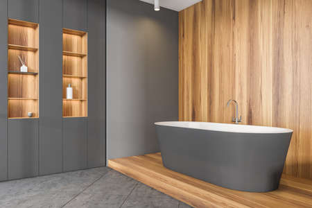 Bathing room interior with bathtub on wooden podium, side view, rack with backlight and accessories. Copy space empty wall. Tiled floor, minimalist modern design, 3D rendering Imagens