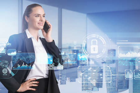 Confident smiling businesswoman talking smartphone, panoramic office interior, white glowing information protection icons. Padlock and business symbols. Concept of cyber security and data storage
