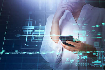 Businesswoman in white shirt is typing on smartphone with hologram of digital interface with globe, bar and pie diagrams. Concept of cloud data storage and information security and communication