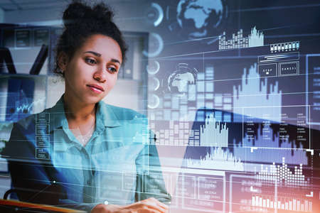 Businesswoman in blue shirt is typing on laptop with hologram of digital interface with globe and bar and pie diagrams. Concept of cloud data storage and information security and communication