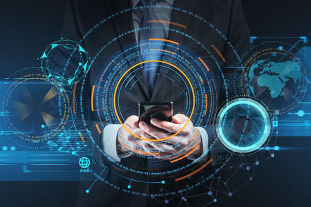 Businessman wearing formal suit is holding smartphone with digital interface hologram in his hand. Hud with globe and padlock icons in the foreground. Concept of future technologies and data security