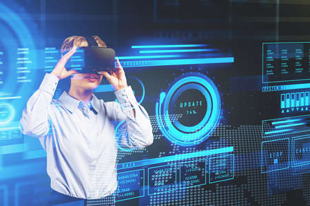 Businesswoman in white shirt is wearing virtual reality helmet. Hologram of digital interface with words update. data and progress in the foreground. Concept of future technologies nowadays