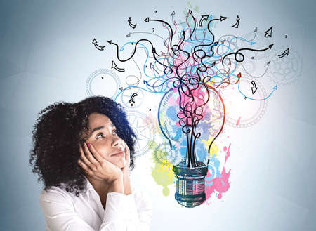 Colorful pink, blue and yellow sketch with light bulb, arrows, lines and cogwheels on wall. Thoughtful businesswoman in background. Concept of imagination and inspiration for creative ideas
