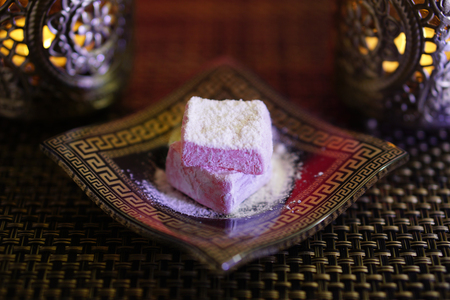 Turkish delight in atraditional glas plate with warm candle light