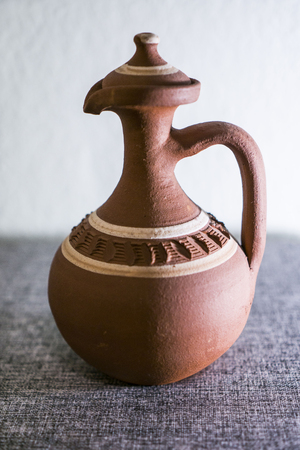 Clay pitcher handmade wtith decoration