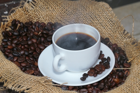 hot a cup of coffee and coffee beans