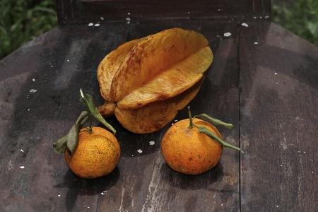 starfruit and orange on teak chair photo