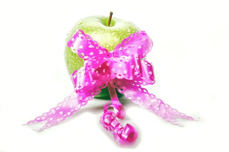green apple with pink ribbon for valentine, white background Stock Photo - 17567703