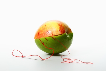 untidy stitching on two color apples, white background Stock Photo - 17567639