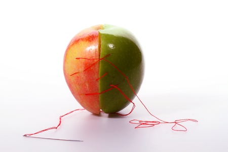 messy stitching on two color apples, white back ground Stock Photo - 17567640