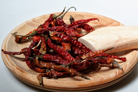 dry chilies on wooden manual grinder Stock Photo - 17567728