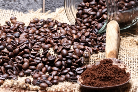 pouring coffee beans of jar photo