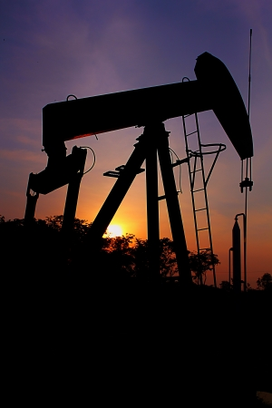 pumping unit: pumping unit sunset on oil field Stock Photo