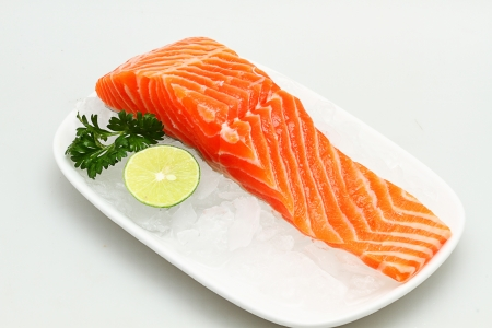 salmon fish meat, garnished,isolated white background Stock Photo