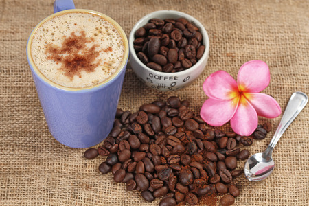 cappuccino with granule and coffee beans