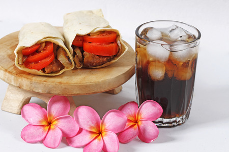donner: chicken wrap and cold cola drink