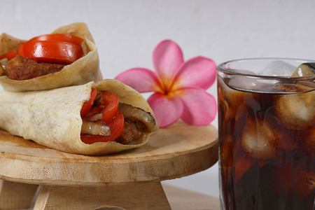 chicken wrap and cold cola drink photo