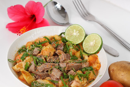 soto betawi, Indonesian meat soup photo
