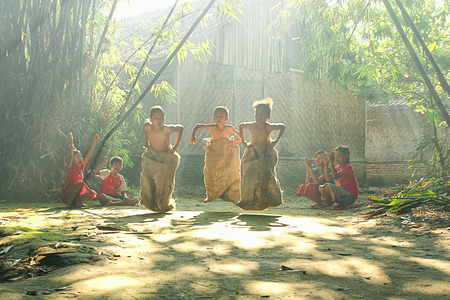 the indonesian flag: Children are playing in their village at Rumpin, Bogor, Indonesia Editorial