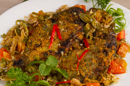 Ikan bawal bakar acar padang, grilled fish with pickled chili, West Sumatera food, Indonesian cuisine photo