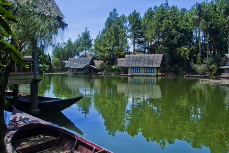 Beautiful Indonesian landscapes, lake view, mountains, hills, waterfalls, village houses photo