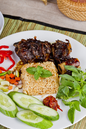 Nasi goreng and sup iga bakar, fried rice and grilled ribs soup, Indonesian cuisine