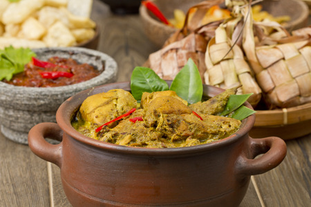 opor ayam, Indonesian chicken Curry Stock Photo - 83156040