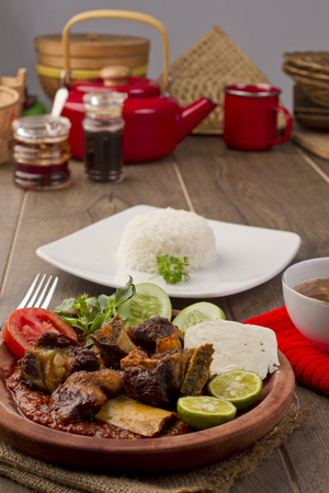 plating: iga penyet, Indonesian Fried Ribs Stock Photo