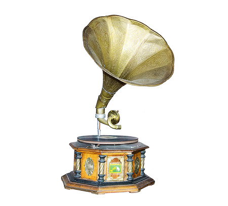 Vintage Golden gramophone isolated on white.